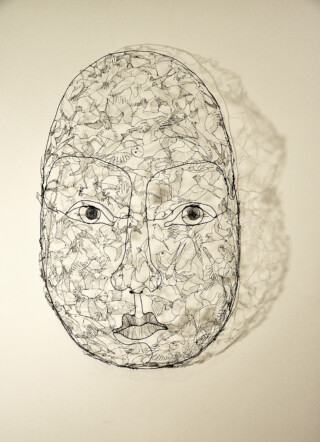 Head full of birds in wire. Sculpture. Fiona Morley
