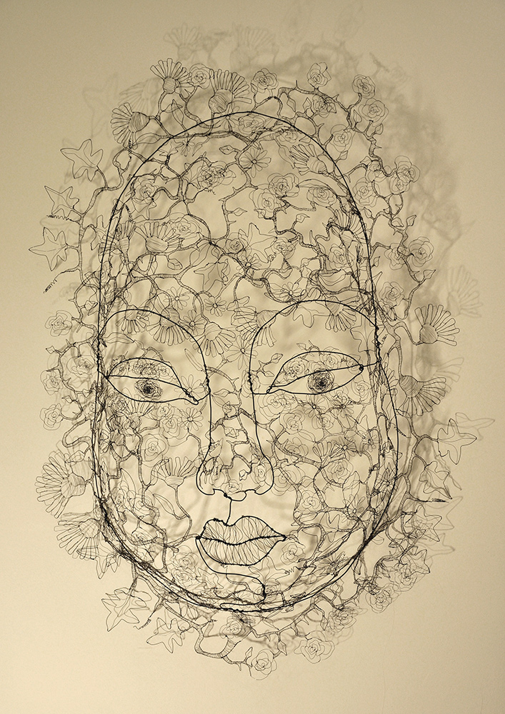 Fiona Morley. Large 3D wire head filled with flowers. In wire