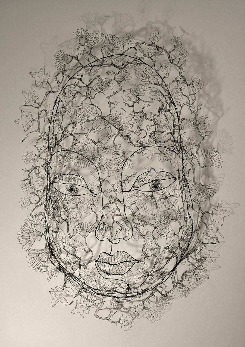 Head full of flowers in wire, Fiona Morley