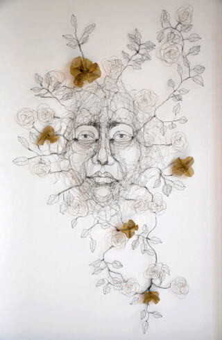 Wandering Fiona Morley. Wire and woven bronze cloth Wire head with leaves and flowers