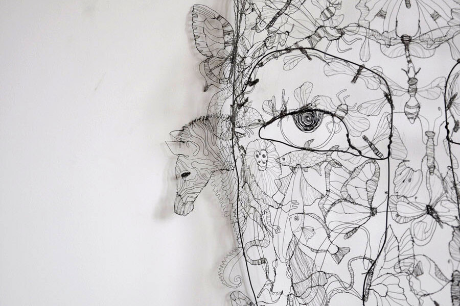 you are everything. fiona morley wire sculpture of face made up of animals and birds